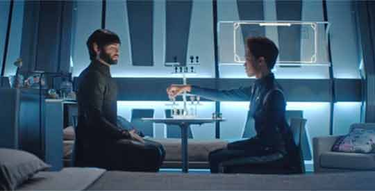 Spock and Burnham play chess.